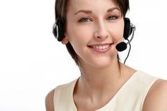 Frauenbediener mit Kopfhörer Stockfoto