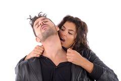 Frauenbissen auf Mann Lizenzfreies Stockfoto