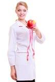 Frauendiätetiker, der gesundes Lebensmittel empfiehlt. Diät. Stockfotos
