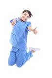 Frauendoktor, der mit dem Daumen oben springt Stockfotografie