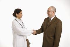 Frauendoktor und -geschäftsmann. Lizenzfreies Stockbild