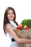 Fraueneinkaufstasche mit Lebensmittelgeschäftgemüse Stockbild