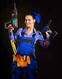 Frauenerbauer mit Bauwerkzeugen. Stockbild