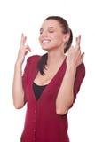 Frauenerscheinen kreuzten Finger stockbild