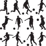 Frauenfußballspielerschattenbild stockbilder