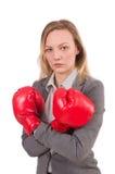 Frauengeschäftsfrau mit Boxhandschuhen Stockfoto