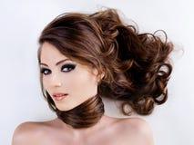 Frauengesicht mit den Schönheitshaaren Lizenzfreies Stockfoto