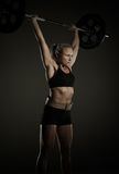 Frauengewichtheben lizenzfreie stockfotografie