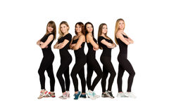 Frauengruppe, die in der Reihe steht Lokalisiert auf Weiß Stockfotos