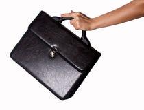 Frauenhände und -koffer lizenzfreies stockbild