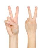 Frauenhand, die Zeichen bildet. Lizenzfreie Stockbilder