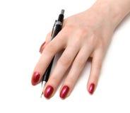 Frauenhand mit Bleistift Lizenzfreie Stockfotografie