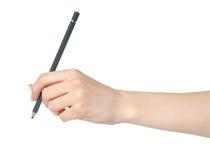 Frauenhand mit Bleistiftschreiben Stockbild