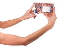 Frauenhand- und Videokarte. Lizenzfreie Stockfotografie