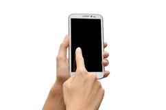 Frauenhand unter Verwendung des HandyTouch Screen stockfotografie