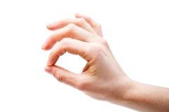 Frauenhand, welche die OKAYgeste, lokalisiert zeigt Stockfotografie
