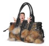 Frauenhandtasche mit kleinem Mann Stockbild