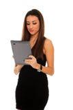 Frauenholding in der Hand eine Tablettenotenauflage Lizenzfreies Stockbild