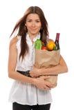 Frauenholding-Einkaufstasche mit vegetarischem Lebensmittelgeschäft Stockfotos