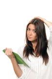 Frauenholding-Lesebuchtablette Lizenzfreie Stockfotos