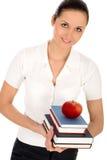 Frauenholdingbücher lizenzfreie stockfotos
