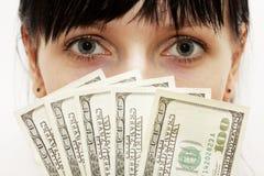 Frauenholdinggeld Stockbild