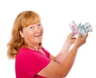 Frauenholdinggeld Lizenzfreie Stockfotos