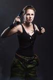 Frauenholdinggewehr mit Rauche Lizenzfreies Stockbild