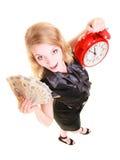 Frauenholdingpoliturgeldbanknote und -Wecker Stockfotografie