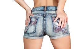 Frauenkarosserie in den Kurzschlüssen des blauen Baumwollstoffs Stockfotografie
