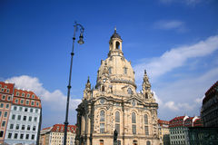 Frauenkirche Dresden. The frauenkirche in dresden surrounded from coloured houses Royalty Free Stock Photos