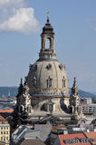 Frauenkirche's dome, dresden. Detail of the dome of our lady church in dresden that stands over city roofs,  the church has been completely rebuilt after second Stock Photos