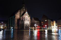 Frauenkirche view at night after rain in Nuremberg. Frauenkirche view at night after rain on Hauptmarkt square in Nuremberg, Bavaria, Germany Royalty Free Stock Image