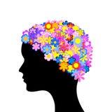 Frauenkopf mit Blumen Lizenzfreie Stockfotografie