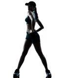 Frauenläuferrüttler, der Schattenbild ausdehnt Lizenzfreies Stockfoto