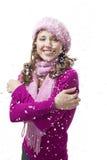 Frauenlächeln, während Schneeflocken fallen Stockfotografie