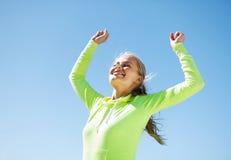Frauenläufer, der Sieg feiert Stockbild