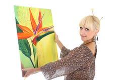 Frauenmaler, der ihre Abbildung über Weiß zeigt Lizenzfreie Stockfotos