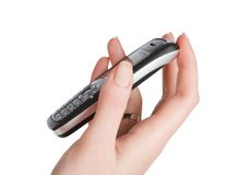 Frauenpalmen-Holding-Handy Stockfoto
