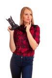 Frauenphotograph, der was denkt zu schießen - lokalisiert auf Weiß Stockbild