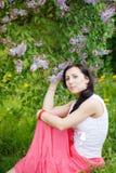 Frauenporträt mit Blumen Lizenzfreies Stockfoto