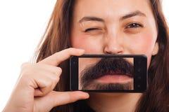 Frauenporträt mit Telefon Stockfotos