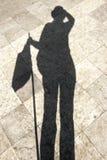 Frauenschatten, schwarzes Licht und Schattenbild Stockbilder