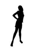 Frauenschattenbild in einer kühlen Haltung Stockfotografie