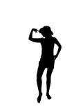 Frauenschattenbild mit einem Hut Lizenzfreie Stockbilder