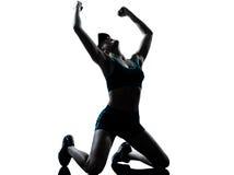 Frauenseitentriebsrüttlerkniensiegersieg Stockfoto