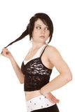 Frauenspitzenoberteilgriff-Haarblick zurück lizenzfreie stockfotos