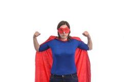 Frauensuperheld mit rotem Kap Stockbild