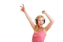 Frauentanzen mit Kopfhörern Lizenzfreie Stockfotografie
