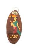 Frauentoilettenzeichen auf natürlichem Teakholzholz Lizenzfreies Stockfoto